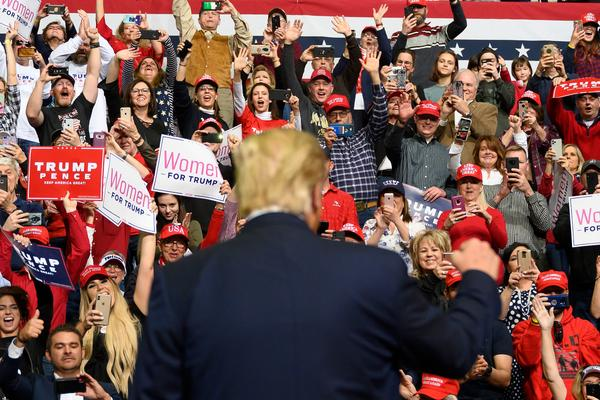 """Supporters cheer as former President Trump arrives to address a """"Keep America Great"""" rally in Colorado Springs, Colo., on Feb. 20, 2020. After his loss, the county GOP faces a deep ideological divide."""