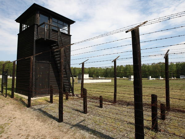A former typist and secretary at the Stutthof concentration camp in Poland is charged with being complicit in mass murder. The camp, seen here in 2016, has become a museum.