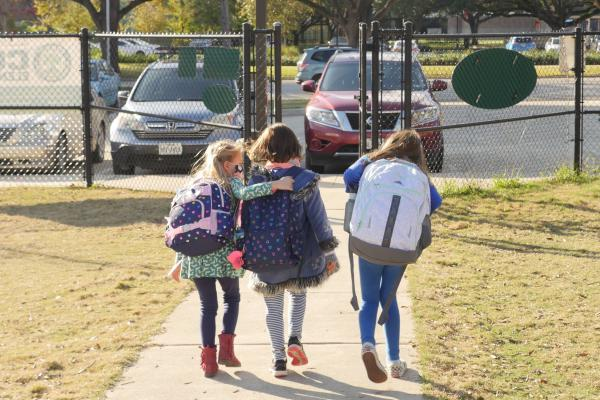 School children wearing facemasks walk outside Condit Elementary School near Houston in December. The U.S. Department of Education announced Friday that it will begin collecting data on the status of in-person learning during the pandemic.