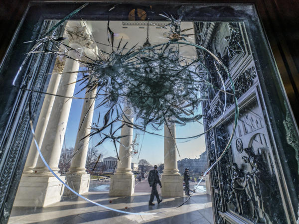 Shattered glass from the attack on the Capitol by a pro-Trump mob is seen in the doors leading to the Capitol Rotunda on Jan. 12.