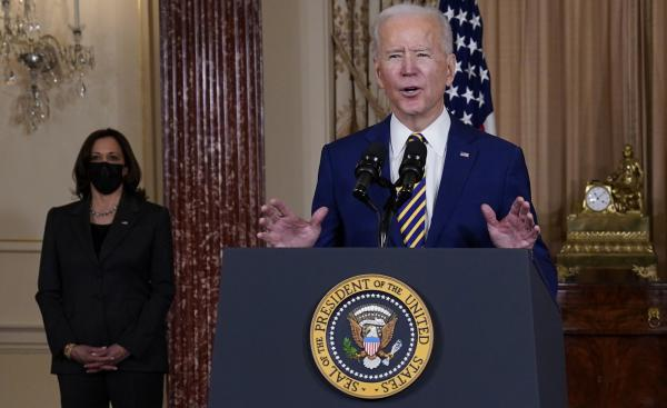 """President Biden speaks at the State Department on Feb. 4 as Vice President Kamala Harris looks on. """"We've elevated the status of cyber issues within our government,"""" said Biden, whose administration is investigating a major cyber breach blamed on Russia."""