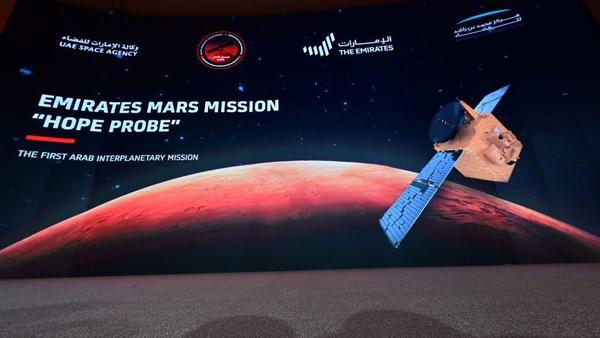 """A picture taken on July 19, 2020, shows a screen broadcasting the launch of the """"Hope"""" Mars probe at the Mohammed Bin Rashid Space Centre in Dubai. """"Hope"""" — Al-Amal in Arabic — is expected to start orbiting Mars this week, marking the 50th anniversary of the unification of the UAE."""