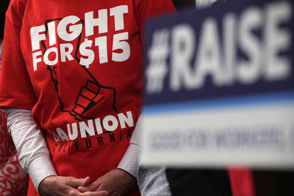 "An activist wears a ""Fight For $15 and a Union"" t-shirt at the U.S. Capitol in 2019 as lawmakers took on legislation to raise the federal minimum wage."