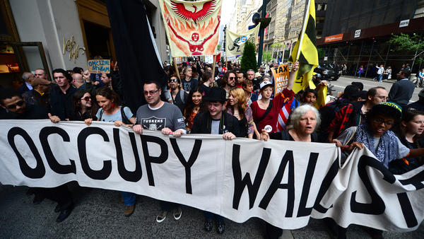 Occupy Wall Street participants march down Fifth Avenue in New York on May 1, 2012. Lingering anger over the 2008 global financial crisis has fueled several populist movements, including most recently, the battle waged by amateur investors coordinating in Reddit against hedge funds.