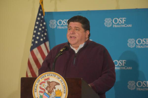 Illinois Gov. JB Pritzker speaks at a press conference in Peoria on Oct. 26, 2020.