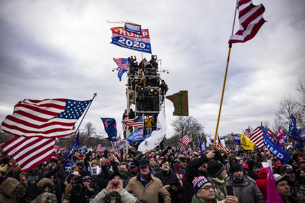 Pro-Trump supporters storm the U.S. Capitol following a rally on Jan. 6. So far, military veterans account for about 15% of those criminally charged in the Capitol riot, according to an NPR analysis.