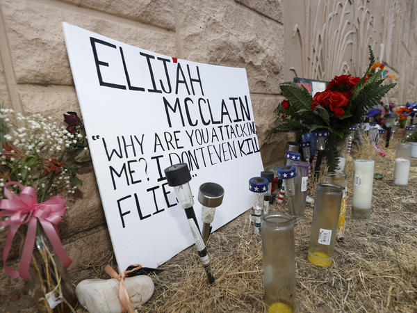 Three Aurora Police Department officers were fired in connection with staged photos wherein one officer held another in an apparent carotid restraint hold. That move was used to subdue Elijah McClain before he died.