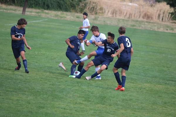 The Phoenix High School boys' varsity soccer team plays Valley Catholic in this 2019 file photo.