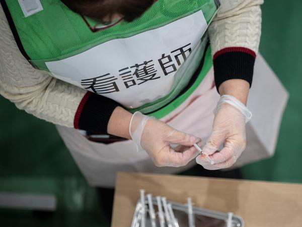 A nurse prepares syringes for a coronavirus vaccination drill in Kawasaki on Jan. 27.