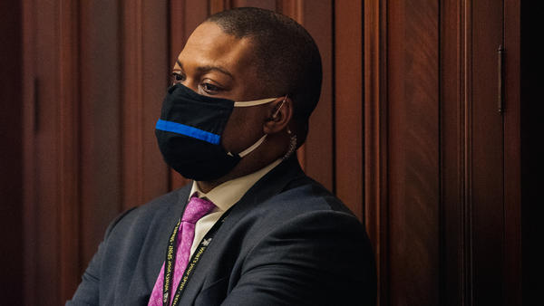 Capitol Police Officer Eugene Goodman watches newly released video footage of the Jan. 6 attack on the Capitol building on Wednesday. Goodman's efforts to protect lawmakers were on display.