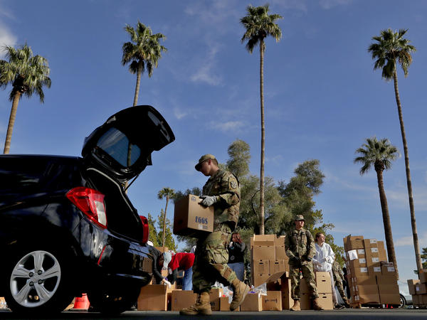 Members of the Arizona National Guard distribute food in Mesa, Ariz., last March in response to surging demand due to the COVID-19 pandemic.