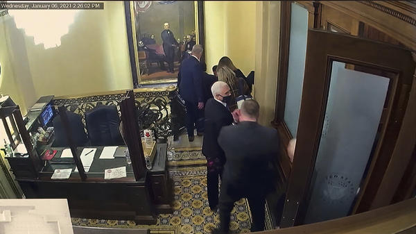 A security video shows then-Vice President Mike Pence being evacuated as rioters breach the Capitol on Jan. 6.