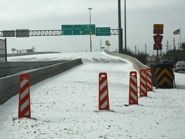 A highway on-ramp in Houston is closed due to snow and ice on Monday. Frigid temperatures, icy roads and power outages caused by a major winter storm have interfered with COVID-19 vaccine distribution in Texas and several other states.