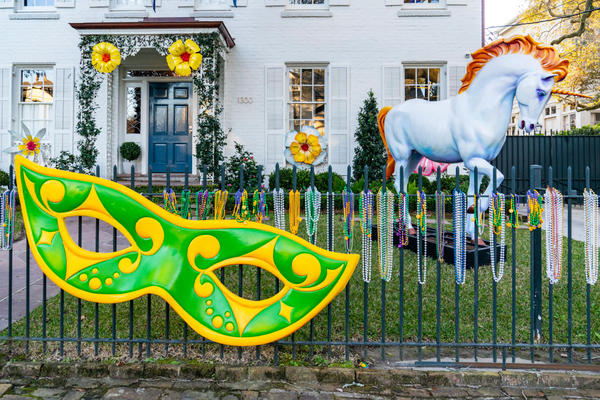A house is decorated with oversized Mardi Gras masks, beads and unicorns on February 7, 2021 in New Orleans, Louisiana. Due to the COVID-19 pandemic cancelling traditional Mardi Gras activities, New Orleanians are decorating their homes and businesses to resemble Mardi Gras floats. (Erika Goldring/Getty Images)