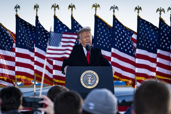 Former President Donald Trump, seen here speaking to supporters on Jan. 20 while still president, attacked Senate Minority Leader Mitch McConnell in a statement Tuesday evening.