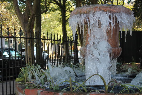A fountain is frozen in the Marigny neighborhood of New Orleans. Feb. 16, 2021.