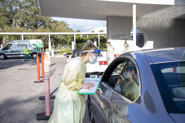 A University of South Florida nursing student receives practical training at a flu drive held in the fall.
