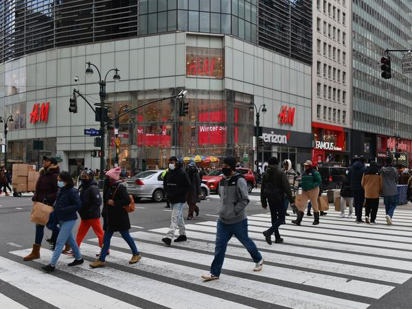 People walk in front of stores in New York's Herald Square. Retail sales soared 5.3% last month compared to December as U.S. families began receiving new federal coronavirus relief checks.