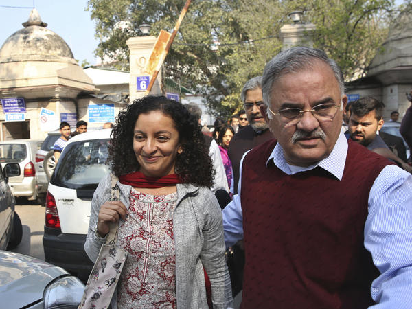 Indian journalist Priya Ramani (left) smiles as she leaves Patiala House Court in New Delhi in 2019. A New Delhi court on Wednesday acquitted Ramani of criminal defamation after she accused a former editor-turned-politician and junior external affairs minister, M.J. Akbar, of sexual harassment.