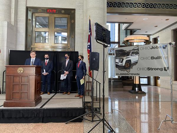 : Lordstown Motors General Counsel Thomas Canepa speaks, as Rep. Mike Loychik (R-Bazetta), Sen. Michael Rulli (R-Salem) and Chris Kerzich, Director of Government Relations and Corporate Affairs for Lordstown Motors, look on.