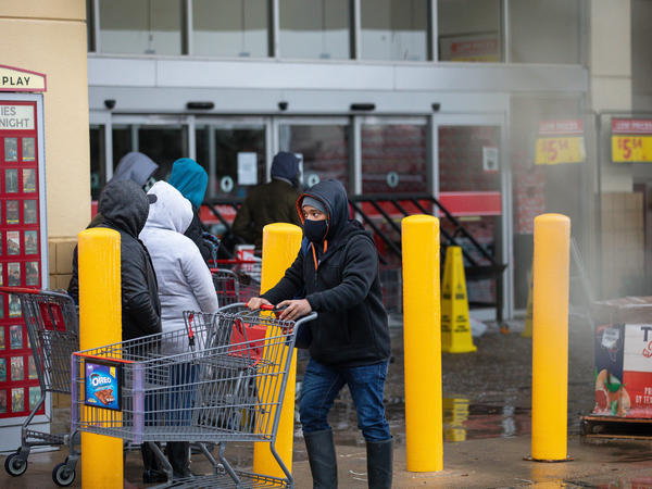 "People wait in long lines at an H-E-B grocery store in Austin, Texas, on Wednesday. The large supermarket chain said the ""unprecedented weather event in Texas has caused a severe disruption in the food supply chain."""