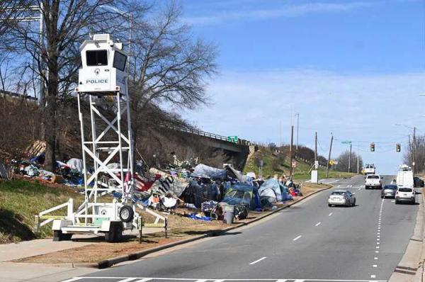 Many homeless have set up tents north of uptown Charlotte along the embankment leading to Interstate 277, property owned by NCDOT.