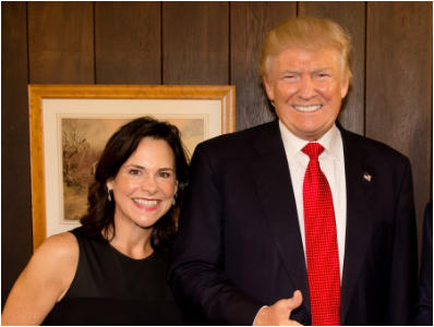 Jane Timken poses with Donald Trump, now the former president, in an undated photo on her campaign website.