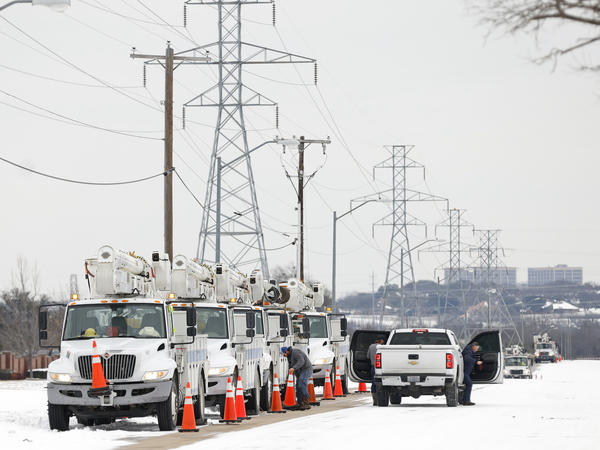 Electric service trucks line up after a snow storm on Feb. 16, 2021 in Fort Worth, Texas. The White House said on Thursday that FEMA was mobilizing to help assist the response to winter weather that has left hundreds of thousands without power in Texas.