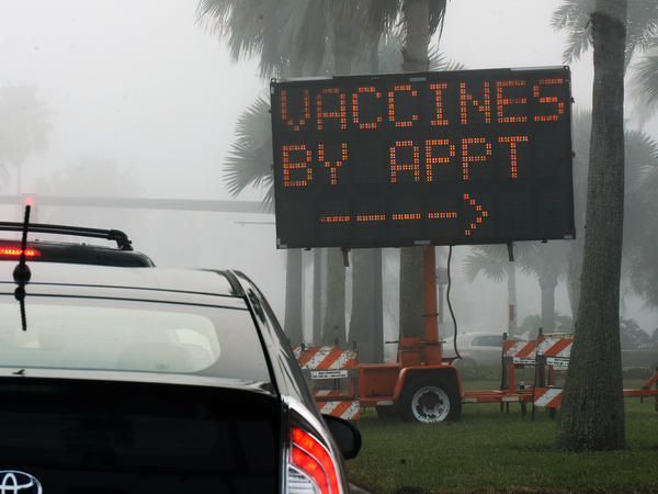 "A sign directs drivers to a COVID-19 vaccination site at the Orange County Convention Center in Orlando, Fla. Health officials in Orange County said on Thursday that two women were caught dressing up as ""grannies"" in an effort to cut the vaccine line."
