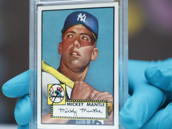 "The ""Holy Grail"" of baseball cards, a 1952 Topps Mickey Mantle, is put on display as part of a baseball memorabilia exhibit at the History Colorado Center on July 16, 2018, in Denver."