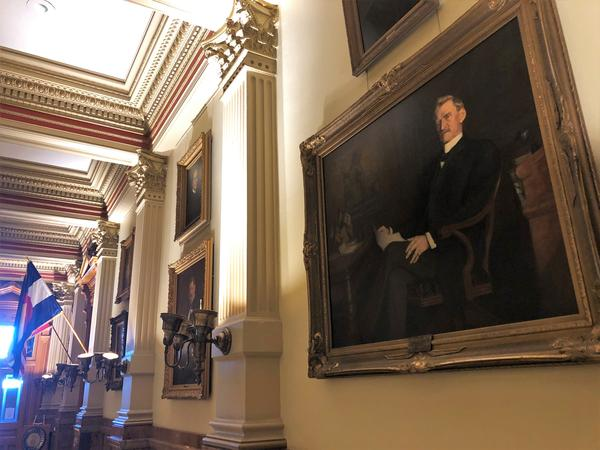 "A portrait of former Colorado Gov. Julius Caldeen Gunter hangs in the state Capitol. A historian says Gunter had a ""halfhearted"" response to the 1918 pandemic and did little to encourage social distancing."