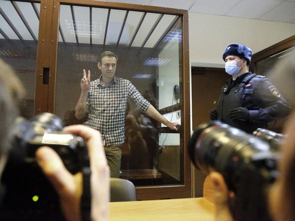 Russian opposition leader Alexei Navalny stands in a Moscow courtroom on Saturday. The court turned down an appeal against his prison sentence.