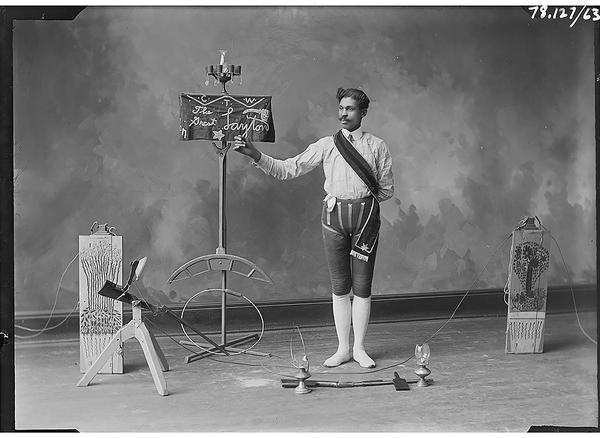 Harrison Putney's portrait of circus performer The Great Layton with his props. Gelatin dry plate negative photographed in Leavennworth, Kansas, from the Amon Carter Museum of American Art, Fort Worth, Texas.
