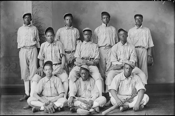 Unknown photographer's group photograph of Young Sports Baseball Team circa 1870s-1900s. Glass plate negatives photographed in Leavennworth, Kansas, from the Amon Carter Museum of American Art, Fort Worth, Texas.