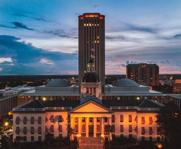 A day before Florida's electors gathered at the Capital Monday, the state's Senate President tested positive for COVID-19.