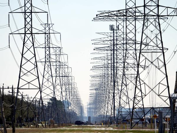 Power lines near Houston on Feb. 16. Some Texas residents are facing enormous power bills after wholesale prices for electricity skyrocketed amid last week's massive grid failure.