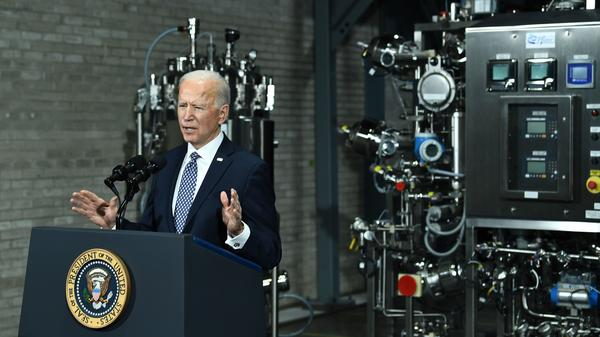 President Biden speaks Friday at a Pfizer COVID-19 vaccine manufacturing site in Portage, Mich. The House could pass a version of his $1.9 trillion COVID-19 relief legislation this week.