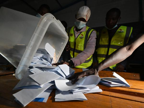 Niger's Electoral Commission workers count the ballots at a polling station during Niger's presidential election runoff in Niamey on Sunday. In the country's west, a vehicle carrying poll workers struck a landmine, killing seven and seriously wounding three others. It's unclear if the vehicle was deliberately attacked.