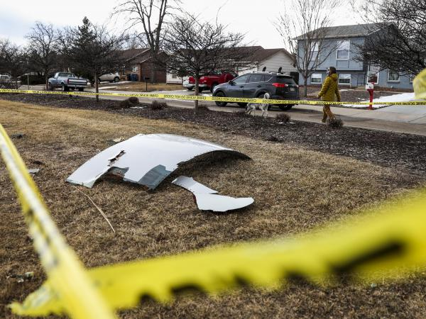 Pieces of the airplane engine from United Airlines Flight 328 sit scattered in a neighborhood after the jet's engine failure on Feb, 20 in Colorado. An engine on the Boeing 777 exploded after takeoff from Denver.
