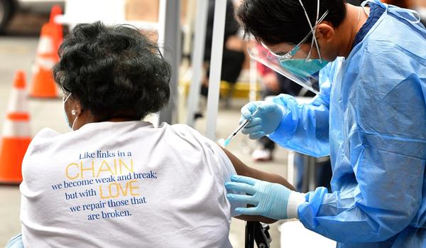A nurse administers the Moderna COVID-19 vaccine during a distribution of vaccines to seniors above the age of 65 who are experiencing homelessness at the Los Angeles Mission, in the Skid Row area of Downtown Los Angeles on Feb. 10. (Frederic J. Brown/AFP via Getty Images)