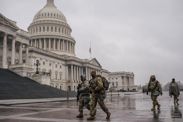 National Guard members walk through the U.S. Capitol grounds following the conclusion of the second impeachment trial of former President Donald Trump on Feb. 13.