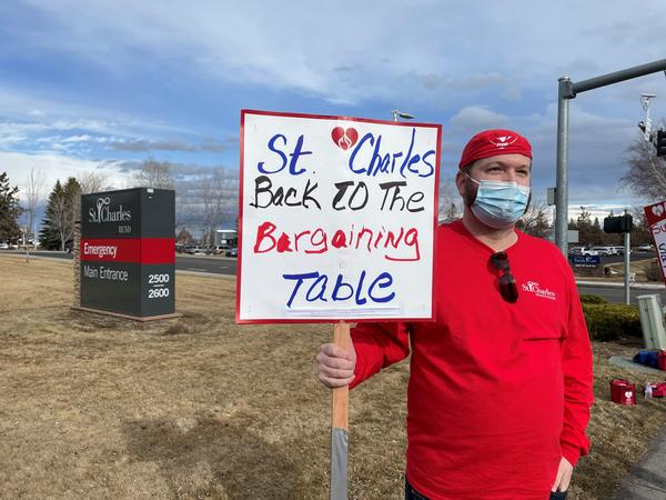 X-ray technician Chriss Curry pickets at St. Charles Medical Center in Bend on Feb. 1, 2021.
