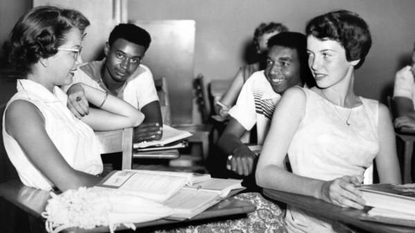 Students chat while waiting for history class to start at Oak Ridge High School in September of 1955, when the once all-white high school was desegregated by order of the Atomic Energy Commission. The Tennessee city's school board is now formally including the story of its integration in its curriculum.