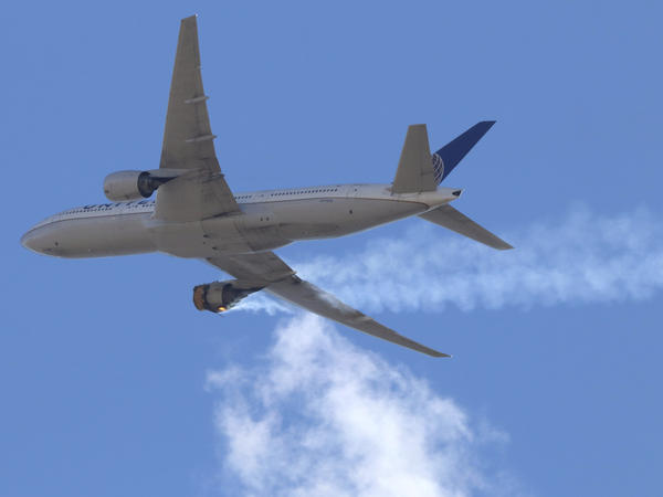 "United Airlines Flight 328 approaching Denver International Airport, after experiencing ""a right-engine failure"" shortly after takeoff from Denver. The FAA issued an order on Tuesday grounding all aircraft powered by the same Pratt & Whitney 4000-112 engine until they've been inspected."