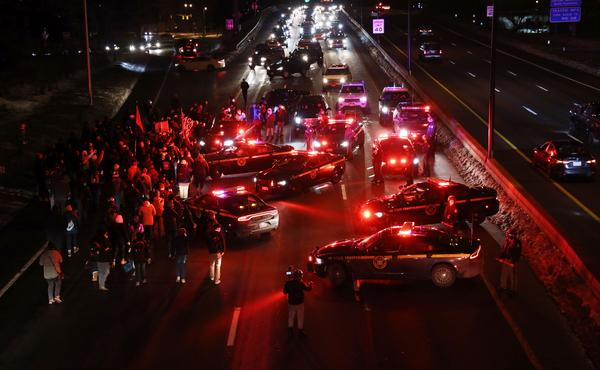 Hundreds of protester marching to the Public Safety Building were along part of I-490 on Tuesday night