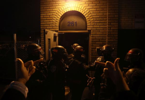 Protesters gather at an RPD station at Campbell and Child Streets