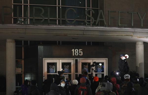 Protesters get up to the front doors of the PSB on Tuesda night