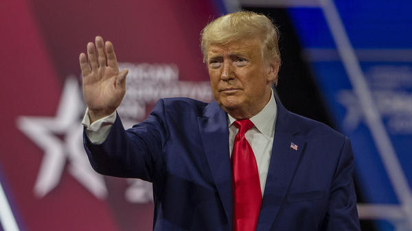 Then-President Donald Trump waves at the crowd during the 2020 Conservative Political Action Conference. This year, Trump is out of office but is still headlining the event.