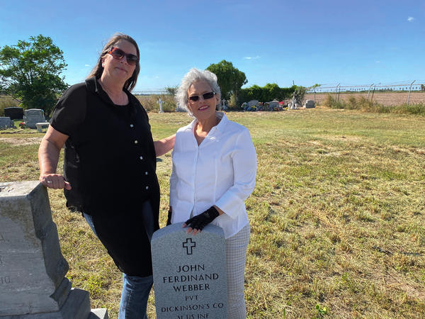 Roseann Bacha-Garza (left), a borderlands historian, stands with Olga Webber-Vasques at the grave of the latter's great-great-grandfather, the abolitionist John Ferdinand Webber, in the family cemetery.