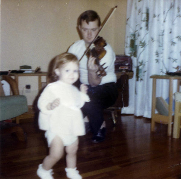 A young Jack Ranney, of Champaign, Ill., plays the violin for his daughter, Jillian. Jack died Nov. 23, 2020, at the age of 80 from COVID-19.